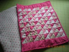 "Doll quilt made for my granddaughter. Approximately 10"" x 14"" in size, this quilt was machine pieced and hand quilted. The HSTs are 1-1/4"" finished and were bonus triangles from Quiltville's 2014 Mystery Quilt."