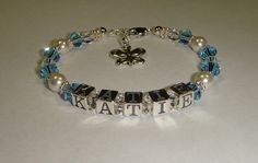 Girl's Birthstone Name Bracelet - Swarovski Pearls & Crystals - Personalized - Charm Choice. $35.00, via Etsy.
