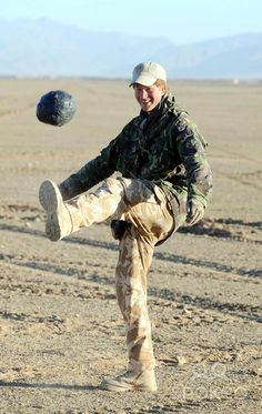 Prince Harry enjoys an early morning kick-about in the desert in Helmand Province