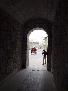 Looking through the pedestrian gate in the stone wall from Quebec city to old Quebec city.
