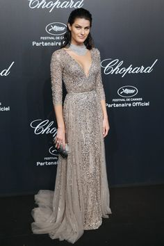 Isabeli Fontana: The model looked lovely in a neutral three-quarter-sleeve gown, covered in jewels and complete with a thin belt.
