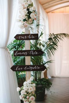 Directional Rustic Sign with Flowers | Photo: Amy & Stuart Photography. View More:  http://www.insideweddings.com/weddings/rustic-elegant-outdoor-ceremony-luxe-garden-inspired-reception/869/