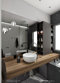 The hero of this bathroom design is the vanity. The palette is Walnut timber, pietra grey marble and grace Bisazza tiles. Minosa Design: Small space feels large