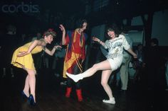 1984-New York, NY: NYC clubs. Photo shows three women dancing on the dance floor at a nightclub in New York City.