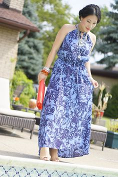 blue floral maxi dress-nude heels-red bag