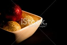 Chocolates bubbles in foil by Gema Ibarra at Istock