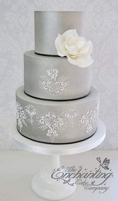 The Enchanting Cake Company. I love the white scroll work on the sides. Maybe a Tiffany Blue cake would be nice.