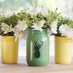 Learn how to make these adorable vases using mason jars, spray paint, and adhesive shipping labels to create the silhouette!