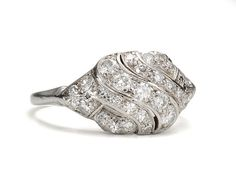 Mid Century Swirl: Diamond Platinum Ring ( I don't like a lot of diamonds, but this is done tastefully.)