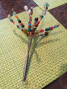 String beads on wire whisk after cutting ends. Great addition to potted flowers Wire Crafts, Bead Crafts, Glass Garden Art, Glass Art, Outdoor Art, Garden Crafts, Recycled Crafts, Wire Art, Beads And Wire