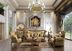 The space is big and has a luxurious and elegant shapes and large sofa chairs and lots of carvings on the sofa and table pingir color gold and there is a small red carpets and large Windows