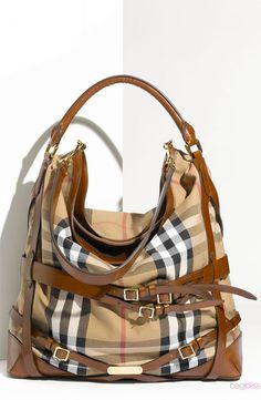 I m not a huge Burberry fan... but this right here. Burberry PurseBurberry  HandbagsFashion ... ff852f3fe9b52