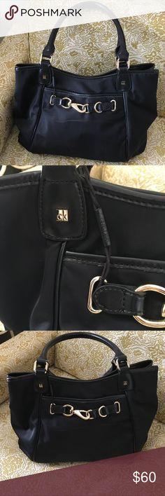 Calvin Klein Leather & Nylon Bag authentic Calvin Klein bag! Barely used , just stored. Excellent condition! Pristine interior! No stains! Exterior is made of nylon which means water and stain resistant. Straps made of  genuine Leather! Only flaw is a little peeling on straps shown. Open to offers Calvin Klein Bags