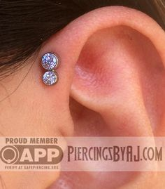 Fresh 16g forward helix with a tanzanite gem cluster from Anatometal. One piercing, two gems!