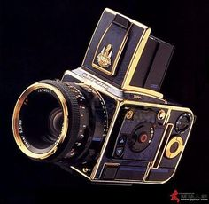 Hassleblad from 1996  for the King of Thailand, Bhumibol Adulyadej Golden Jubilee Edition. Nine units were apparently made with it's 24 carat gold plating. Some have auctioned for $50,000