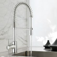 Minimalist Spring Pull Down Sink Mixer with Twin Action Spray available now at #TheBlueSpace