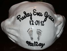 Birth announcement belly cast with baby's foot prints!