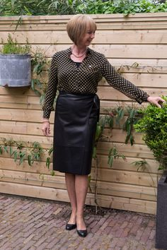 Yellow polka dot blouse with black leather skirt