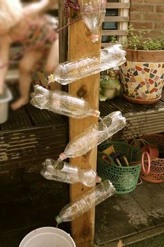 Easy way to incorporate water in the outdoor area. So cool and the children would have a blast.