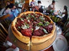 """Chicago Pizza: 2"" deep, cornmeal crust, whole pear tomatoes, cheese under sauce, chunky garlic-filled goodness, cooked to perfection with fillings like Masa's secret recipe Sweet Italian Sausage and Scala's Giardiniera"" (Masa of Echo Park, 1800 West Sunset Blvd. Los Angeles, CA 90026)"