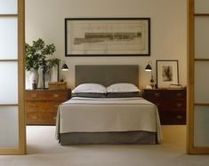 Asian-Modern Bedroom. Clean fresh lines on the bed and added warmth from the wood chests of drawers.