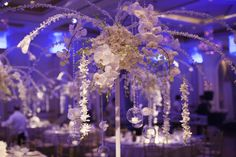 White Floral in a purple lit room at the wedding location of The Grove in Cedar Grove, New Jersey