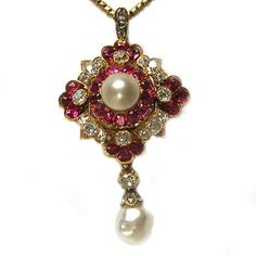 A Victorian natural pearl, ruby and diamond cluster pendant