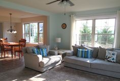behr aqua breeze in a sunny modern living room with a coastal decorating style