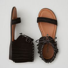 AEO Minnetonka Havana Sandals ($60) ❤ liked on Polyvore featuring shoes, sandals, black, american eagle outfitters, kohl shoes, black tie shoes, tie sandals and fringe shoes