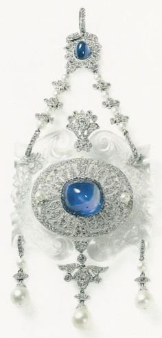 A Belle Époque rock crystal, diamond, star sapphire, pearl and platinum pendant, by Cartier Paris, circa 1912. One of Cartier's first creations made with rock crystal. #Cartier #BelleEpoque #pendant