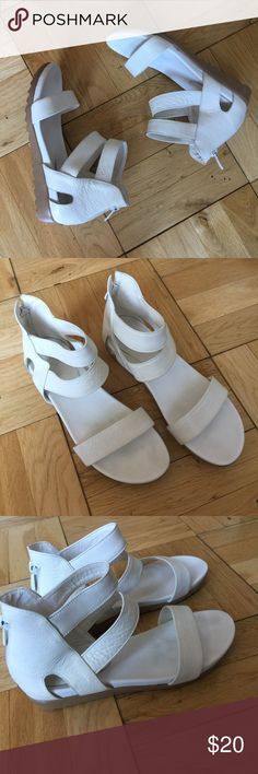 White leather platform sandals Super cute white leather platform sandals. Beige platform. Zip closure in the back.  🔸Size 7.5 🔸Condition: Great Shoes Sandals