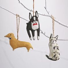 The furry pals featured in Our Tree's Best Friend Ornaments will add a jolly touch to any Christmas tree.  Each one sports a cozy scarf and intricate embroidered details.  Designed exclusively for us by Gingiber. Nod exclusiveA Gingiber designSold individuallyChoose from 2 animals: Doxie (Dauschund) or CatEach ornament features beautiful embroidered details and hanging stringGreat addition to any tree or ornament standShow 'em what you're made ofCotton with polyester filling.