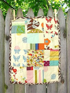I'm pretty sure I've already pinned this quilt but I just love the fabrics here, especially those butterflies!!