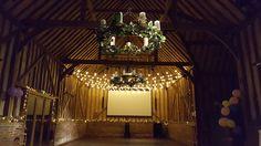 A lovely festoon light canopy over the all important dancefloor @lillibrooke  #festooncanopy #barnweddings #weddinglighting