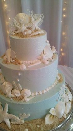 2014 beach wedding seashells and starfish cake - layered beach wedding cake. :: Like the detail in the decorations but how simple it is in white.