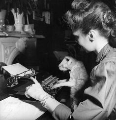 "The caption on this photo is, ""A woman teaching her kangaroo to type."" Which begs the question, ""Why?"""
