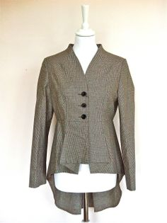 L'Ecole Nationale Houndstooth Tail Coat via The Queen Bee. Click on the image to see more!