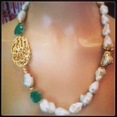 Baroque pearl necklace with emerald and islamic calligraphy brooch in yellow gold by lebanese designer Aurore Ezzedine