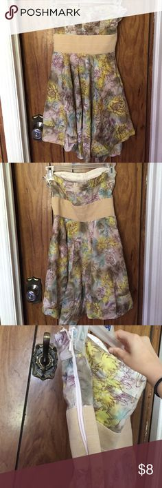 Final Price! Cute Floral Strapless Dress Up for grabs.. A pretty floral strapless dress great to wear this summer! Like new not worn. Too small :( has zipper on side to fit in easier. Off white color with purple, blue, yellow, and green colors to make it look Summerish! Dresses Strapless