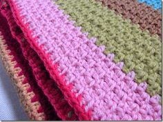 This blanket is done in woven stitch (photo tutorial here), which is nothing more than sc, ch1 across, and then on the next row, the single crochets go in the ch1 spaces, and the chain 1s go above the single crochets.