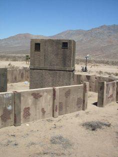 Village RHU structures inside compound walls, makes targets harder for training.