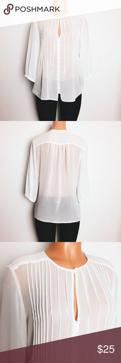 """NY&Co bright white sheer chiffon blouse Delicate and pretty bright white sheer chiffon blouse.  Bracelet sleeve, matching white buttons.  Perfect for the office!   Condition: basically NWOT, no flaws, bright white Size: M Chest: 21 inches across  Length: 26"""" Arms: 18""""  Fabric: polyester  🚫trade New York & Company Tops Blouses"""
