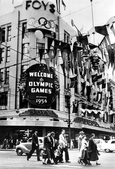 FOYS department store on cnr Bourke & Swanston streets welcomes visitors to the 1956 Melbourne Olympic Games.