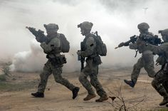 U.S. Army Rangers from United States Army Special Operations Command (Airborne) conduct close-quarters battle drills at a range May 04. The Rangers were part of a capabilities exercise for members of the local populace in Fayetteville.(U.S. Army Photo by Trish Harris-Brownlee)