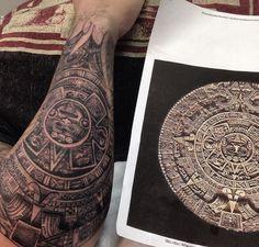 Aztec calendar forearm half sleeve tattoo.