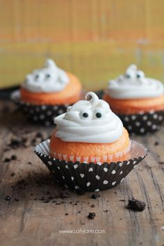 Orange Fanta GHOST Cupcakes, perfect for Halloween! Sprinkled with crushed OREO's to look like dirt. Boo!