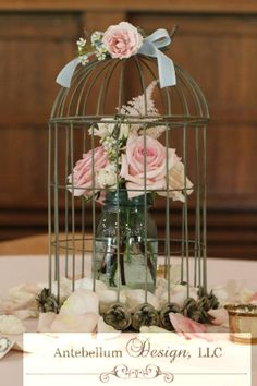 vintage birdcage and teal mason jar reception centerpiece filled with blush wedding flowers by AntebellumDesign.com