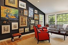 Dramatic gallery wall uses the unique contours of the room to its advantage [Design: Slater Interior Design]
