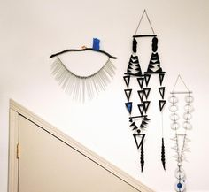 New wall hangings, waiting to be shipped (the blue tape is an identifier for retailers). Levine has been playing around with taking her wall hangings off the wall and creating 360 degree mobiles, and with incorporating the pieces into lamps.