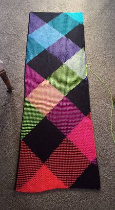 """Planned pooling with crochet Red Heaert Super Saver Neon Stripes """"I"""" hook with 31 moss stitches per color.."""